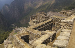 Machu Picchu ruins on the cliff. Machu Picchu ruins on the edge of the cliff overlooking Urubamba river valley Stock Photography
