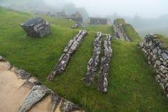 Machu Picchu site in fog stock image