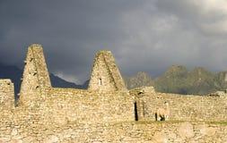 Machu Picchu Storm. Photo of Machu Picchu building with lama and storm clouds approaching stock photo