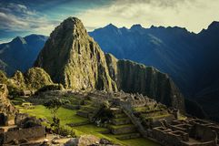 Machu Picchu. Sunset at Machu Picchu, Peru. Mountain of Huayna Picchu rising above Incan ruins of Machu Picchu - Sacred Valley Stock Photography