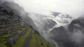 Machu picchu terraces. Ancient field terraces of Machu Picchu in deep fog, panoramic footage stock footage