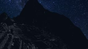 Machu Picchu time lapse at night with stars