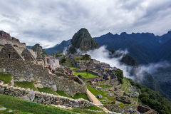 Machu Picchu. View With Dry Moat In Foreground, Main Plaza Beyond, and Huayna Picchu in Background Stock Photo