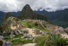 Machu Picchu. View Of Machu Picchu With Quarry, Sacred Plaza, Three Doorway Sector and Huayna Picchu In Background Royalty Free Stock Image