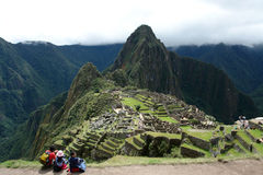 Machu picchu view. With three travelers in the foreground world wonder Royalty Free Stock Photos