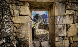 Machu Piccu in Peru. View of the Huayna Picchu through a stone gate of Machu Piccu Royalty Free Stock Photo