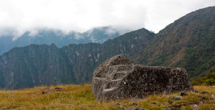 Machu Pichu - Ceremonial Stone at the Guardhouse. A ceremonial stone at the guardhouse at Machu Picchu Royalty Free Stock Image