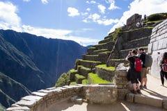 Machu Pichu in Peru. Machu Pichu, Peru - May 16 : Tourists exploring the Lost City of the Incas or Machu Pichu, beautiful site in Peru. May 16 2016, Machu Pichu stock photography