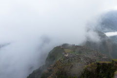 Machu Pichu in the Rain. Early morning at the top of Machu Pichu looking down thru fog and rain adding the element of mystic to this this beautiful landscape royalty free stock photography
