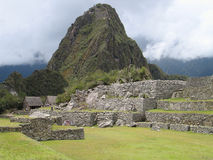 Machupicchu - Waynapicchu. Waynapicchu - Young Peak - situated at the end of the famous Incatown Machupicchu, with the logdes, where each climber has to register royalty free stock photo