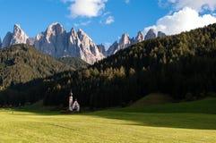 Macic place - Chapel of Saint Johann with wonderful view to impressive Dolomite peaks stock image