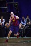 Maciej Lampe of FC Barcelona. KYIV, UKRAINE - NOVEMBER 14, 2013: Maciej Lampe of FC Barcelona controls a ball during Turkish Airlines Euroleague basketball game Stock Image