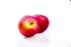 Macintosh Apple på den vita bakgrunden Royaltyfria Bilder