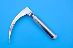 Macintosh laryngoscope on blue background Royalty Free Stock Photography