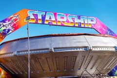 A Fast Spaceship Thrill Ride At A Carnival. MACKAY, QUEENSLAND, AUSTRALIA - JUNE 2019: A fast thrill ride for older children, teenagers and adults at Mackay royalty free stock photo