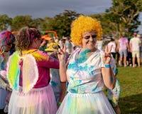 Happy Woman In Orange Wig At Color Frenzy Fun Run. MACKAY, QUEENSLAND, AUSTRALIA - JUNE 2019: Unidentified woman in orange wig posing happily prior to a Color stock images