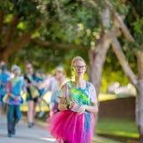 Young Girl Walks In Color Frenzy Fun Run. MACKAY, QUEENSLAND, AUSTRALIA - JUNE 2019: Unidentified young girl participating in Color Frenzy Fun Run stock photos