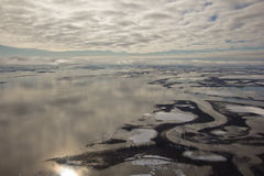 Mackenzie River Delta, NWT, Canada. Some of the many channels and ponds of the Mackenzie River Delta during the Spring ice breakup period Stock Photography