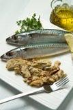 Mackerel. Fiillet with fresh ingredients on white dish Royalty Free Stock Photo