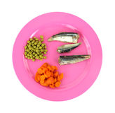 Mackerel carrots and peas on a pink dish Stock Photos