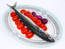 Mackerel with cherry tomatoes and red onions Royalty Free Stock Photos