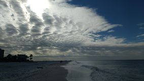 Mackerel clouds. Cloudy morning at Siesta key Beach stock images