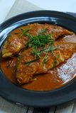 Mackerel in dried red curry stock photo