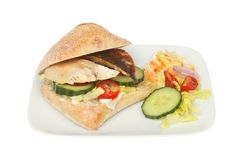 Mackerel fillet in a roll. Mackerel fillet with salad in a ciabatta roll on a plate with salad garnish isolated against white Stock Images