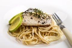 Mackerel fillet on spaghetti with bechamel sauce Stock Photos