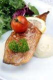 mackerel fillet with tomato on mash potato Stock Images