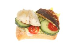 Mackerel fillets on ciabatta. Mackerel fillets and salad on ciabatta bread isolated against white stock photos