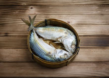 Mackerel fish. In the basket on the wood background Royalty Free Stock Photo