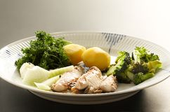 Mackerel fish dish with potatoes, broccoli, onions and parsley. Fatty, oily fish is an excellent and healthy source. Of DHA and EPA, which are two key types of stock photo