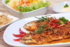Mackerel fish fried topped spicy curry with side dish. Selective focus. Stock Images