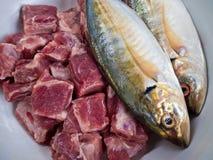 Mackerel fish and Pork bones. Food ingredients Mackerel fish and Pork bones Stock Image