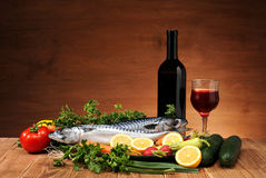 Mackerel fish, vegetables and wine Stock Photo