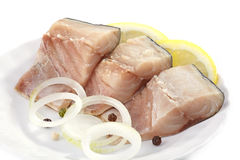 Mackerel pieces. On white plate Royalty Free Stock Images