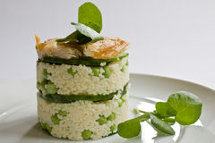 Mackerel Salad Stack. A stack of cous cous, cucumber, peas and smoked mackerel pieces garnished with watercress Stock Photography