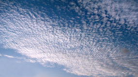 Mackerel sky clouds stock image