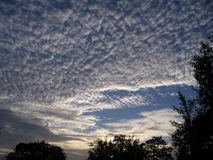 Mackerel sky early in the morning. Morning and a beautiful mackerel sky just after sunrise royalty free stock photos
