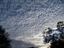 Mackerel sky in the morning. Looking southeast towards a sun beginning to rise and a mackerel sky stock photo