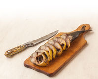 Mackerel smoked chopped to pieces on a cutting board Stock Images