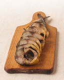 Mackerel smoked chopped to pieces on a cutting board Royalty Free Stock Images