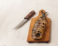 Mackerel smoked chopped to pieces on a cutting board Stock Image