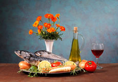 Mackerel, vegetables and flowers Royalty Free Stock Image