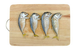 Mackerels on chopping block Royalty Free Stock Image