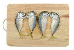 Mackerels on chopping block Royalty Free Stock Images
