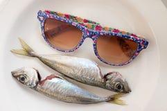 Mackerels and glasses Royalty Free Stock Photo