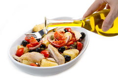 Mackerels with potatoes,tomatoes,capers and olives Royalty Free Stock Photos