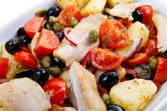 Mackerels with potatoes,tomatoes,capers and olives Stock Images